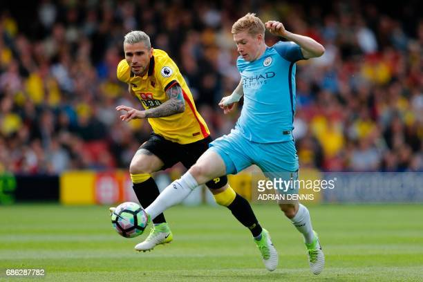 Watford's Yugoslavianborn Swiss midfielder Valon Behrami vies with Manchester City's Belgian midfielder Kevin De Bruyne during the English Premier...