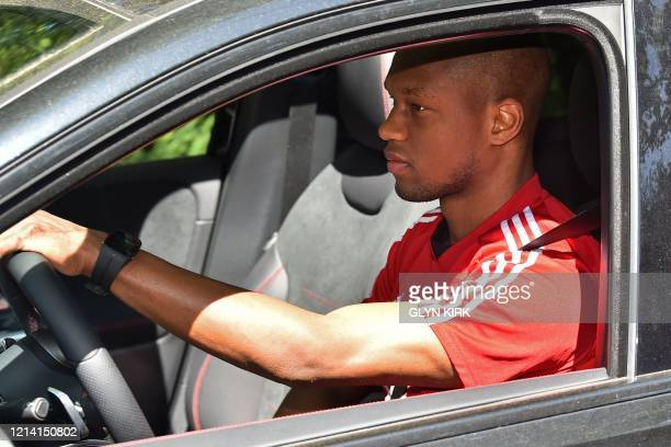 Watford's Zaireborn Belgian defender Christian Kabasele arrives at Watford's training facility at London Colney in north London on May 20 2020 as...