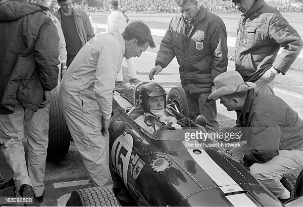 Watkins Glen Formula 1 AAR founder and driver Dan Gurney sits in his Westlake powered V12 Eagle T1G talking to team manager Bill Dunne