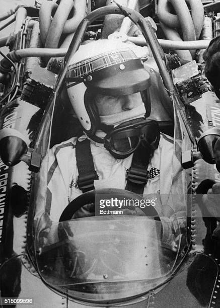 Watkins Glen, NY: Jackie Stewart of Scotland is surrounded by a maze of tubes and pipes that help make up a BRM Formula One race car. Stewart will...