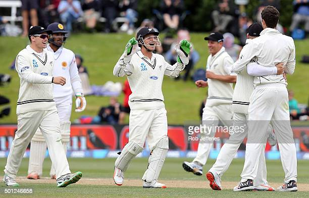 Watling and his New Zealand teammates rush to congratulate Mitchell Santner of his dismissal of Dinesh Chandimal of Sri Lanka during day five of the...