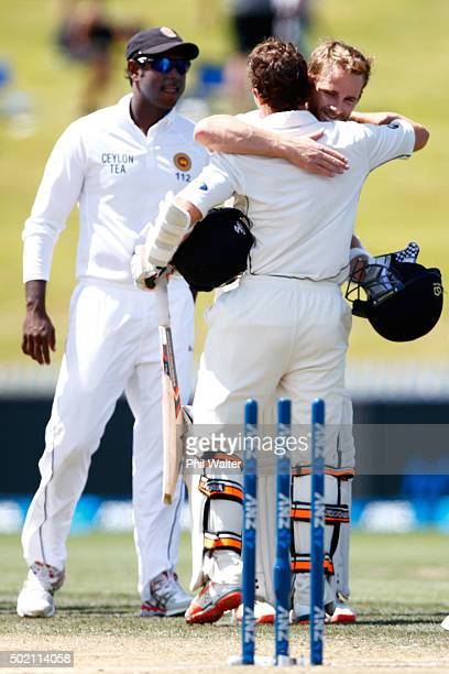 Watling and Kane Williamson of New Zealand embrace at the end of day four of the Second Test match between New Zealand and Sri Lanka at Seddon Park...