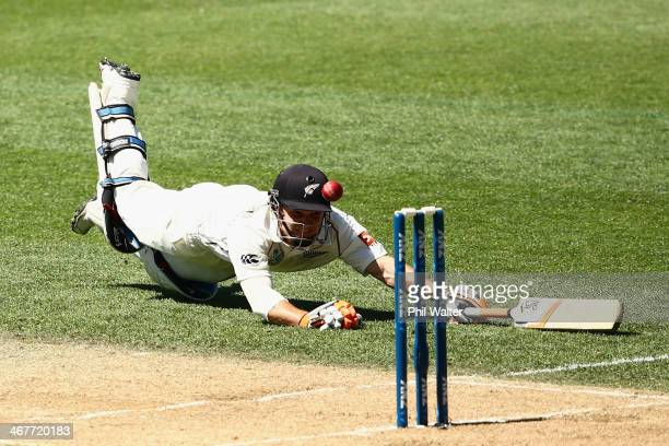 Watling dives into his crease during day three of the First Test match between New Zealand and India at Eden Park on February 8 2014 in Auckland New...
