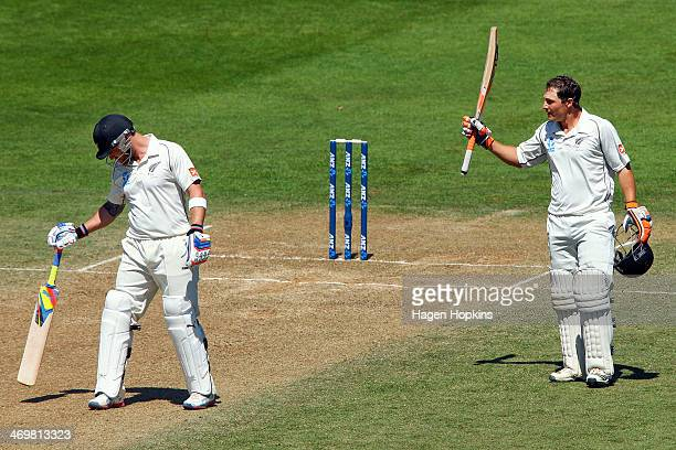 Watling of New Zealand celebrates his century while teammate Brendon McCullum looks on during day four of the 2nd Test match between New Zealand and...
