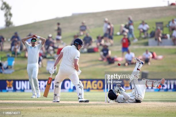 Watling of New Zealand fails to get under the ball from the bat of Dom Sibley of England during day four of the first Test match between New Zealand...
