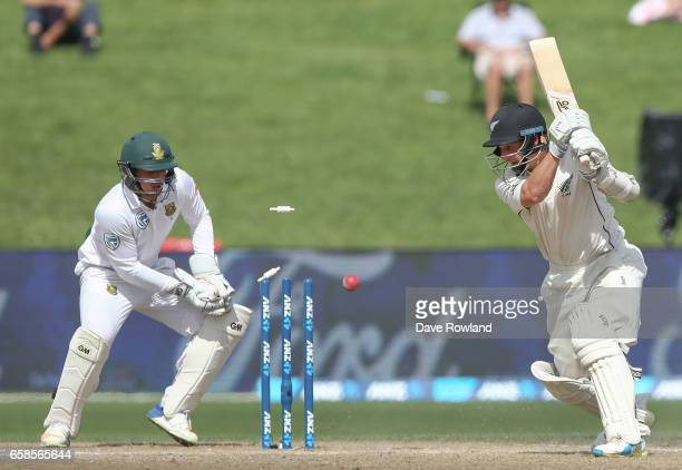 Watling of New Zealand is bowled out by Keshav Maharaj of South Africa during day four of the Test match between New Zealand and South Africa at...