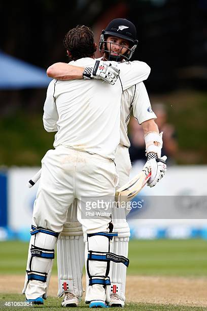 Watling of New Zealand is congratulated on making his century by Kane Williamson during day four of the Second Test match between New Zealand and Sri...