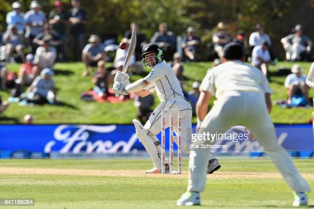 Watling of New Zealand looks on as James Anderson of England takes a catch to dismiss him during day five of the Second Test match between New...