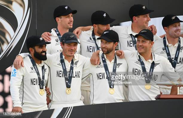 Watling of New Zealand speaks to Devon Conway and Neil Wagner after victory in the Reserve Day of the ICC World Test Championship Final between India...
