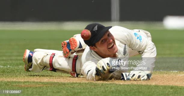 Watling of New Zealand stops a ball during day 4 of the second Test match between New Zealand and England at Seddon Park on December 02 2019 in...