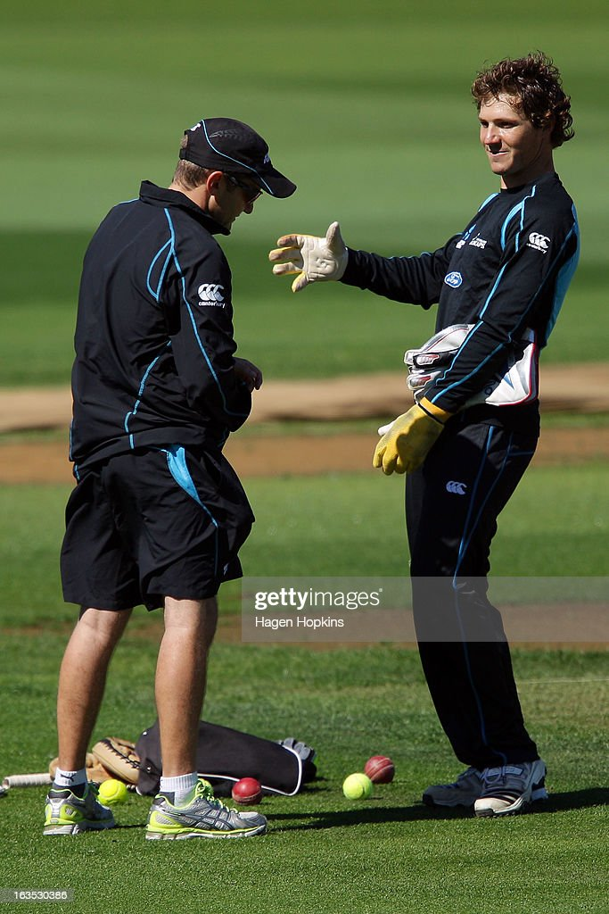 BJ Watling speaks to coach Mike Hesson during a New Zealand training session at Basin Reserve on March 12, 2013 in Wellington, New Zealand.