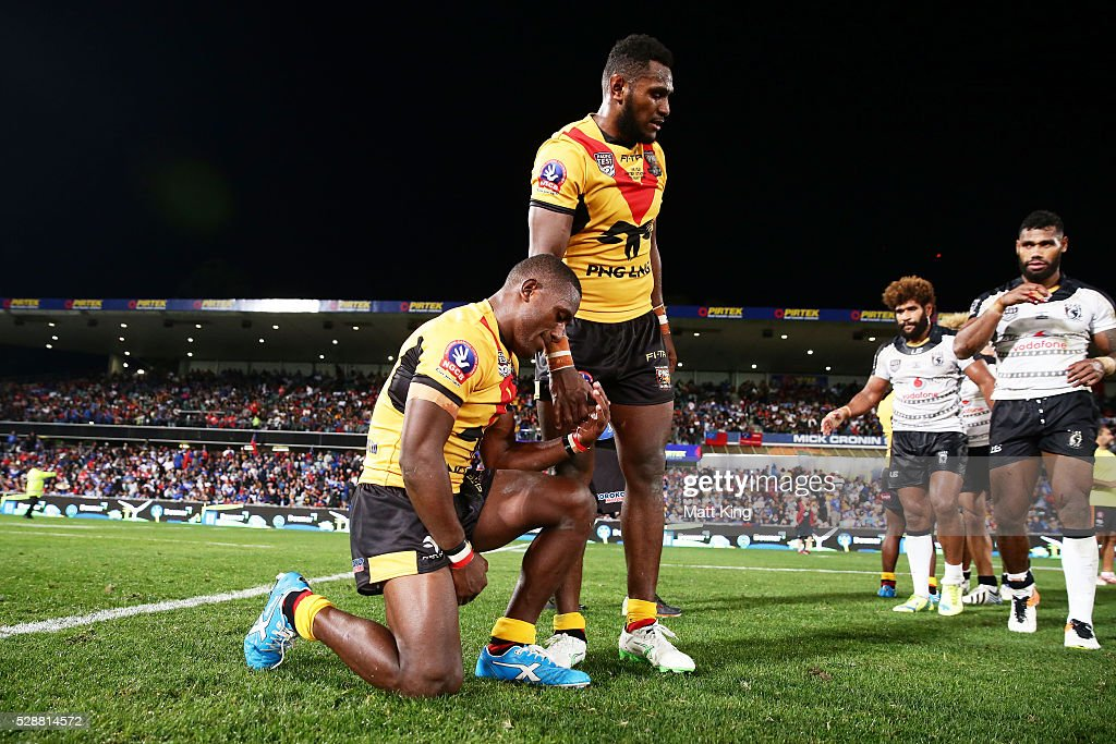Watson Boas of Papua New Guinea (L) celebrates victory with Kato Ottio of Papua New Guinea (R) at the end of the International Rugby League Test match between Fiji and Papua New Guinea at Pirtek Stadium on May 7, 2016 in Sydney, Australia.