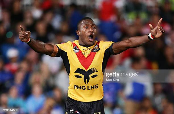 Watson Boas of Papua New Guinea celebrates victory with team mates at the end of the International Rugby League Test match between Fiji and Papua New...