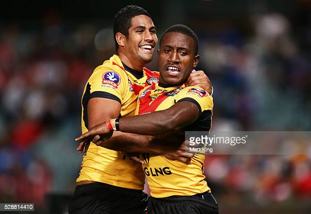 Watson Boas of Papua New Guinea celebrates with Nene Macdonald of Papua New Guinea after scoring a try during the International Rugby League Test...