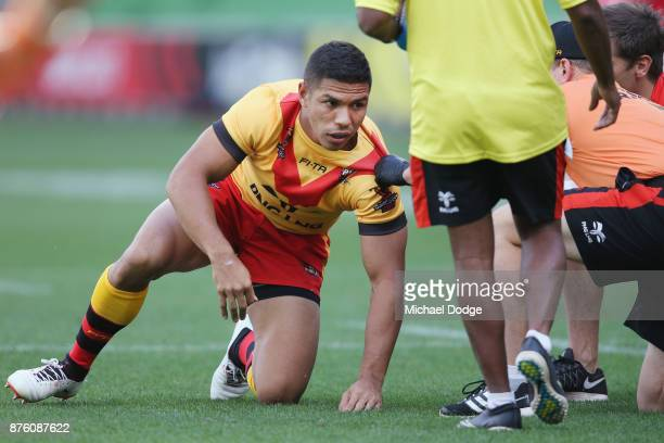 Watson Boas of Papua New Guinea recovers after trying to tackle Luke Gale of England during the 2017 Rugby League World Cup Quarter Final match...