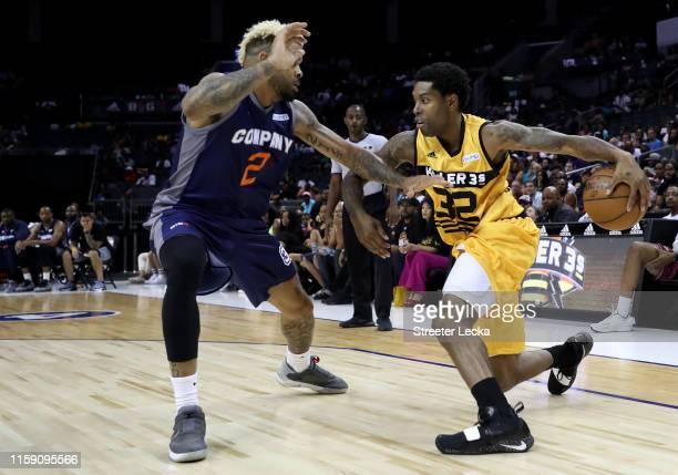 Watson of Killer 3s drives to the basket against Andre Emmett of 3's Company during week two of the BIG3 three on three basketball league at Spectrum...