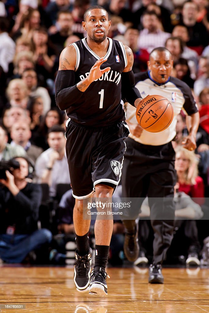 C.J. Watson #1 of the Brooklyn Nets calls a play out to his teammates against the Portland Trail Blazers on March 27, 2013 at the Rose Garden Arena in Portland, Oregon.