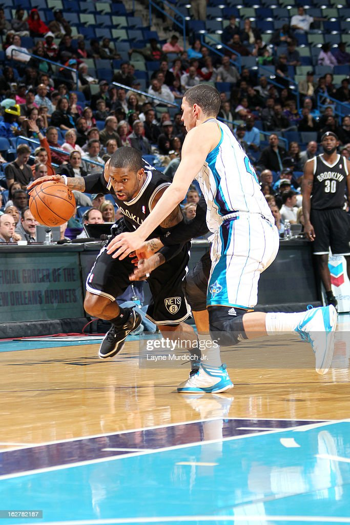 C.J. Watson #1 of the Brooklyn Nets drives against Austin Rivers #25 of the New Orleans Hornets on February 26, 2013 at the New Orleans Arena in New Orleans, Louisiana.