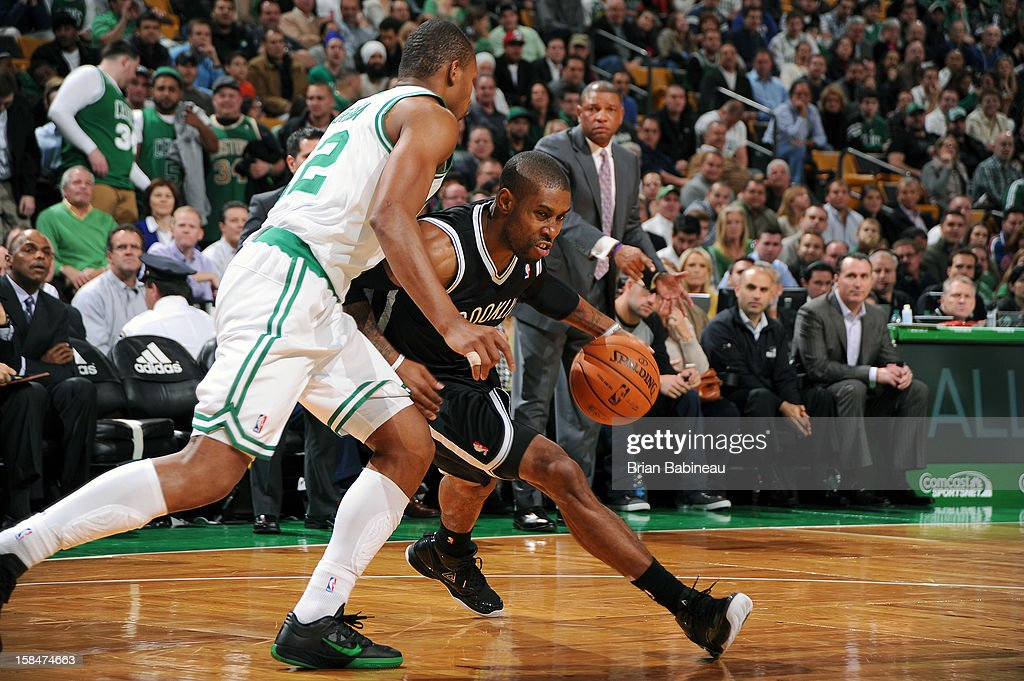 C.J. Watson #1 of the Brooklyn Nets drives against Leandro Barbosa #12 of the Boston Celtics on November 28, 2012 at the TD Garden in Boston, Massachusetts.