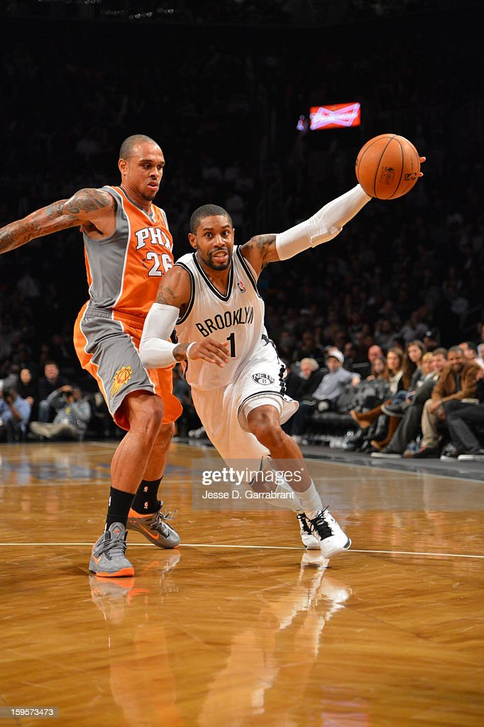 C.J. Watson #1 of the Brooklyn Nets drives to the basket against the Phoenix Suns at the Barclays Center on January 11, 2013 in Brooklyn, New York.