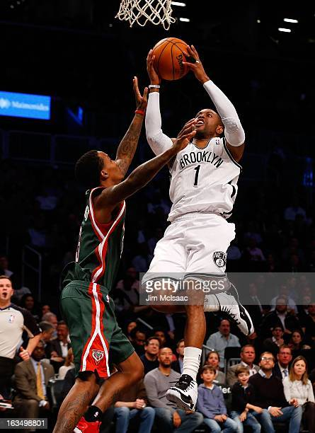 CJ Watson of the Brooklyn Nets in action against Brandon Jennings of the Milwaukee Bucks at Barclays Center on February 19 2013 in the Brooklyn...