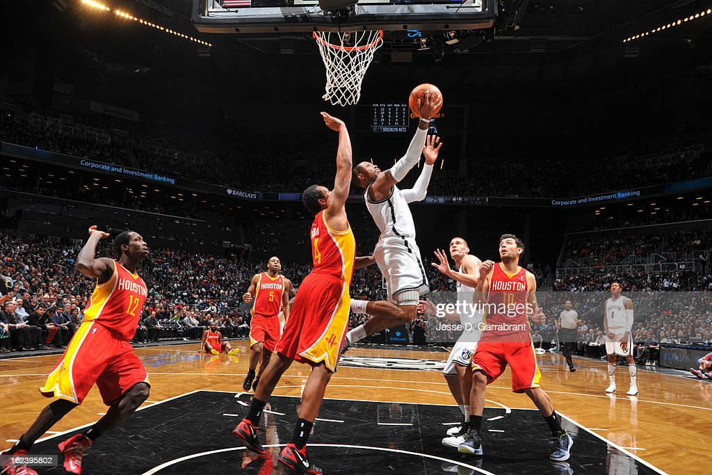 C.J. Watson #1 of the Brooklyn Nets shoots a layup against Greg Smith #4 of the Houston Rockets at the Barclays Center on February 22, 2013 in Brooklyn, New York.