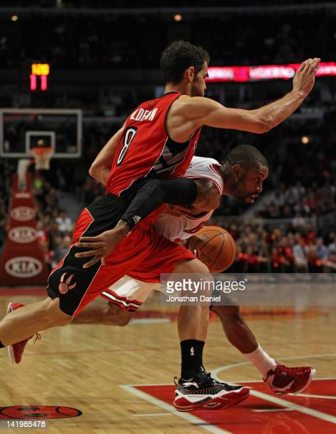 J Watson of the Chicago Bulls drives around Jose Calderon of the Toronto Raptors at the United Center on March 24 2012 in Chicago Illinois The Bulls...