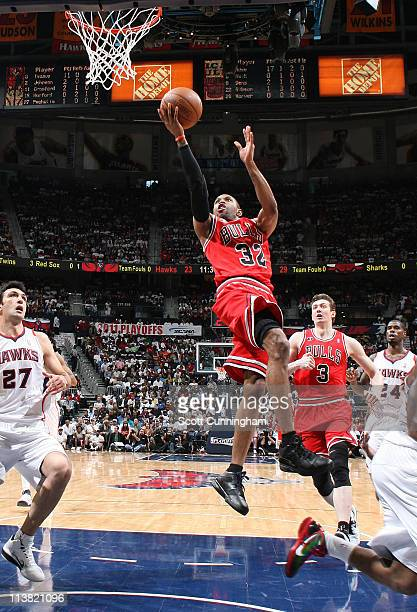 J Watson of the Chicago Bulls shoots against Zaza Pachulia of the Atlanta Hawks in Game Three of the Eastern Conference Semifinals in the 2011 NBA...