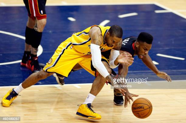 J Watson of the Indiana Pacers and Norris Cole of the Miami Heat battle for a loose ball during Game Two of the Eastern Conference Finals of the 2014...