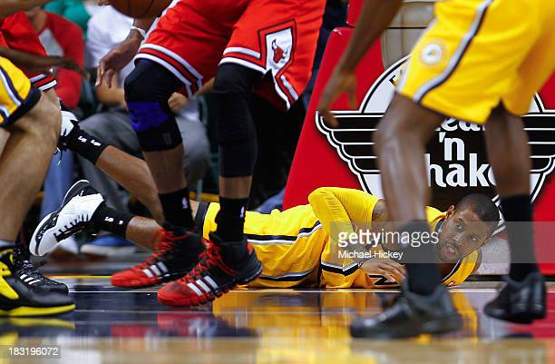J Watson of the Indiana Pacers crashes on the floor after losing his footing during action against the Chicago Bulls on October 5 2013 at Bankers...