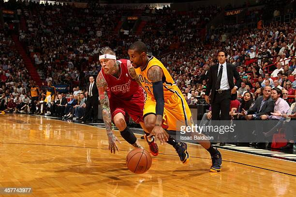 J Watson of the Indiana Pacers drives to the basket against the Miami Heat on December 18 2013 at American Airlines Arena in Miami Florida NOTE TO...