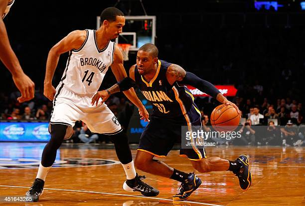 CJ Watson of the Indiana Pacers in action against Shaun Livingston of the Brooklyn Nets at Barclays Center on November 9 2013 in the Brooklyn borough...