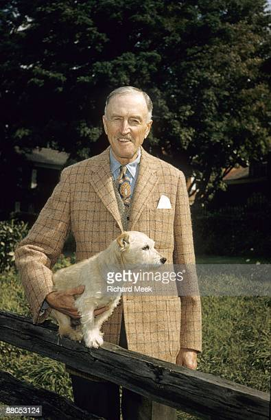 Portrait of J Watson Webb former polo star master of foxhounds and big game hunter with Sandy a Shelburne terrier the breed first developed by Mr...