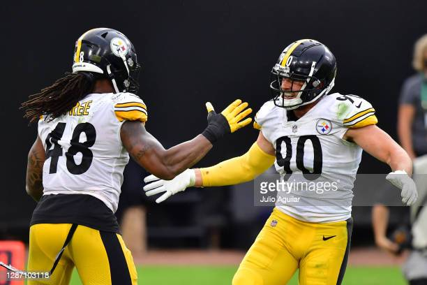 Watt and Bud Dupree of the Pittsburgh Steelers react during the second half against the Jacksonville Jaguars at TIAA Bank Field on November 22, 2020...