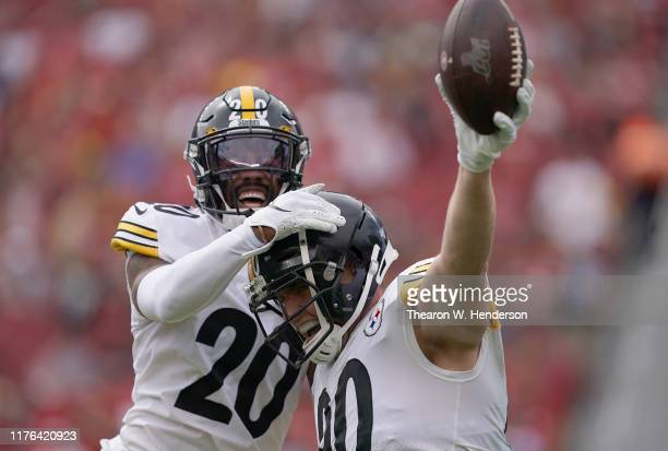 Watt and Cameron Sutton of the Pittsburgh Steelers celebrates after Watt intercepted a pass against the San Francisco 49ers during the first quarter...