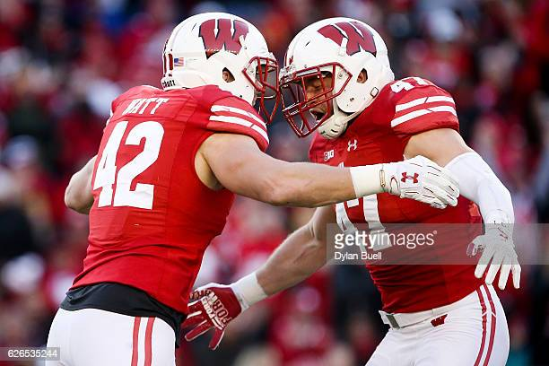 J Watt and Vince Biegel of the Wisconsin Badgers celebrate after recording a sack in the second quarter against the Minnesota Golden Gophers at Camp...