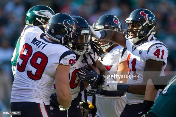 Watt, Jadeveon Clowney, Christian Covington, and Zach Cunningham of the Houston Texans celebrate after Clowney recovered a fumble against the...