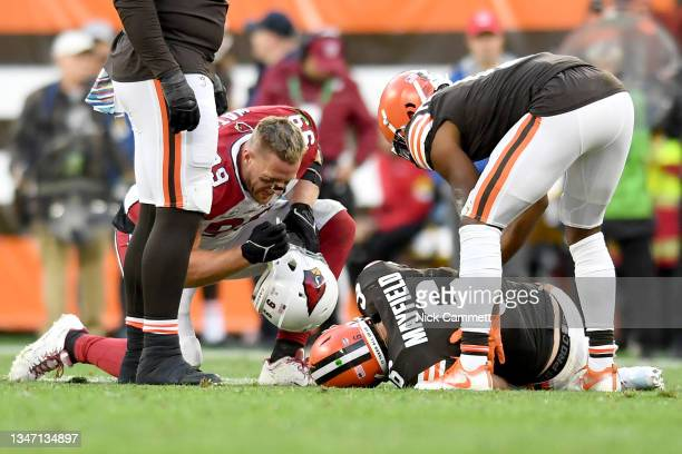 Watt of the Arizona Cardinals checks on Baker Mayfield of the Cleveland Browns after an injury on a stripped sack during the third quarter at...