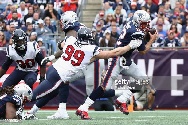 Watt of the Houston Texans attempts to tackle Tom Brady of the New England Patriots during the second half at Gillette Stadium on September 9, 2018...
