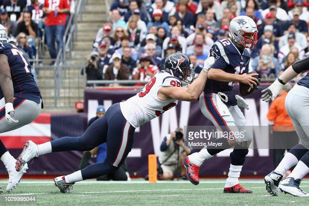 J Watt of the Houston Texans attempts to tackle Tom Brady of the New England Patriots during the second half at Gillette Stadium on September 9 2018...