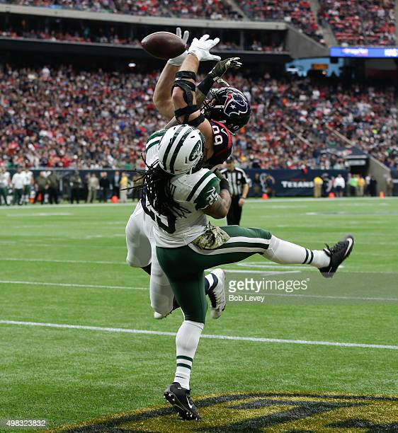 J Watt of the Houston Texans can't come up with the pass as he his defended by Calvin Pryor of the New York Jets in the first quarter at NRG Stadium...