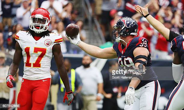 J Watt of the Houston Texans celebrates a fumble recovery as Chris Conley of the Kansas City Chiefs looks on in the first quarter of their game at...