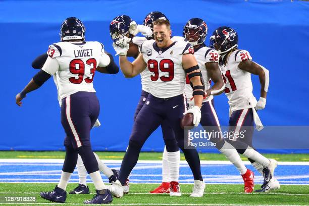 Watt of the Houston Texans celebrates a touchdown after intercepting a pass during the first half against the Detroit Lions at Ford Field on November...