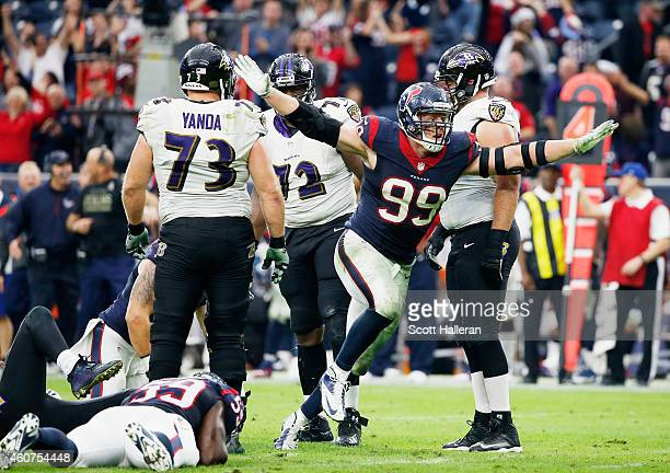 J Watt of the Houston Texans celebrates after a sack during their game against the Baltimore Ravens at NRG Stadium on December 21 2014 in Houston...