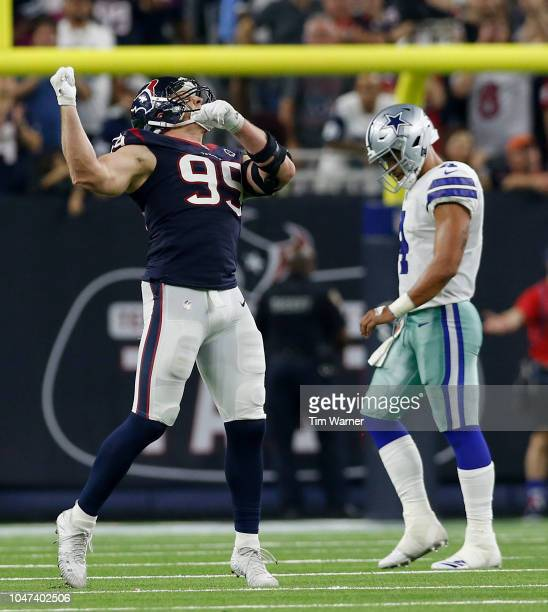 Watt of the Houston Texans celebrates after sacking Dak Prescott of the Dallas Cowboys in the fourth quarter at NRG Stadium on October 7, 2018 in...