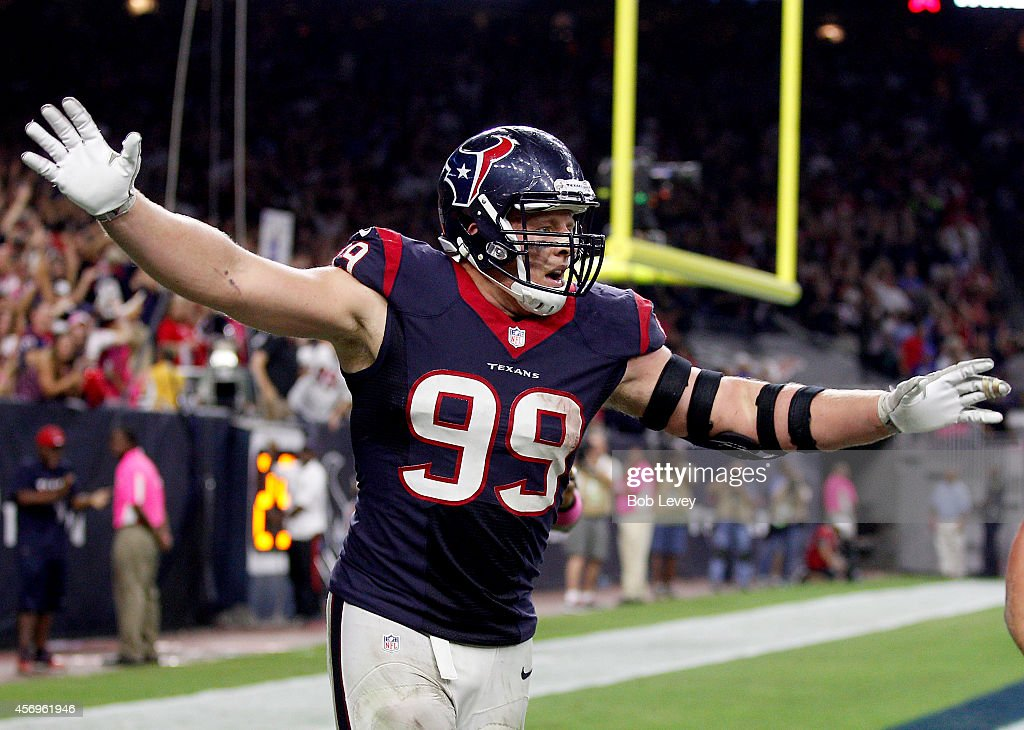 J.J. Watt #99 of the Houston Texans celebrates an Indianapolis Colts fumble after he returned it for a touchdown in the fourth quarter in a NFL game on October 9, 2014 at NRG Stadium in Houston, Texas.