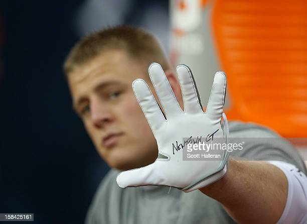 Watt of the Houston Texans displays a glove to remember the victims of the massacre at Sandy Hook Elementary School in Newtown, Connecticut prior to...