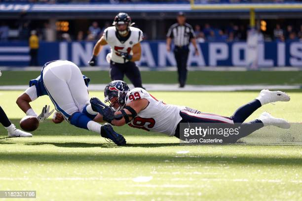 Watt of the Houston Texans dives after a lose ball during the game against the Indianapolis Colts during the second quarter at Lucas Oil Stadium on...