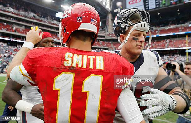 J Watt of the Houston Texans greets Alex Smith of the Kansas City Chiefs on the field after the Chiefs defeated the Texans 2720 at NRG Stadium on...