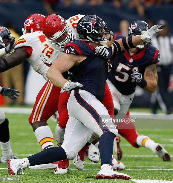 J Watt of the Houston Texans is blocked by Eric Fisher of the Kansas City Chiefs in hte fourth quarter at NRG Stadium on September 18 2016 in Houston...